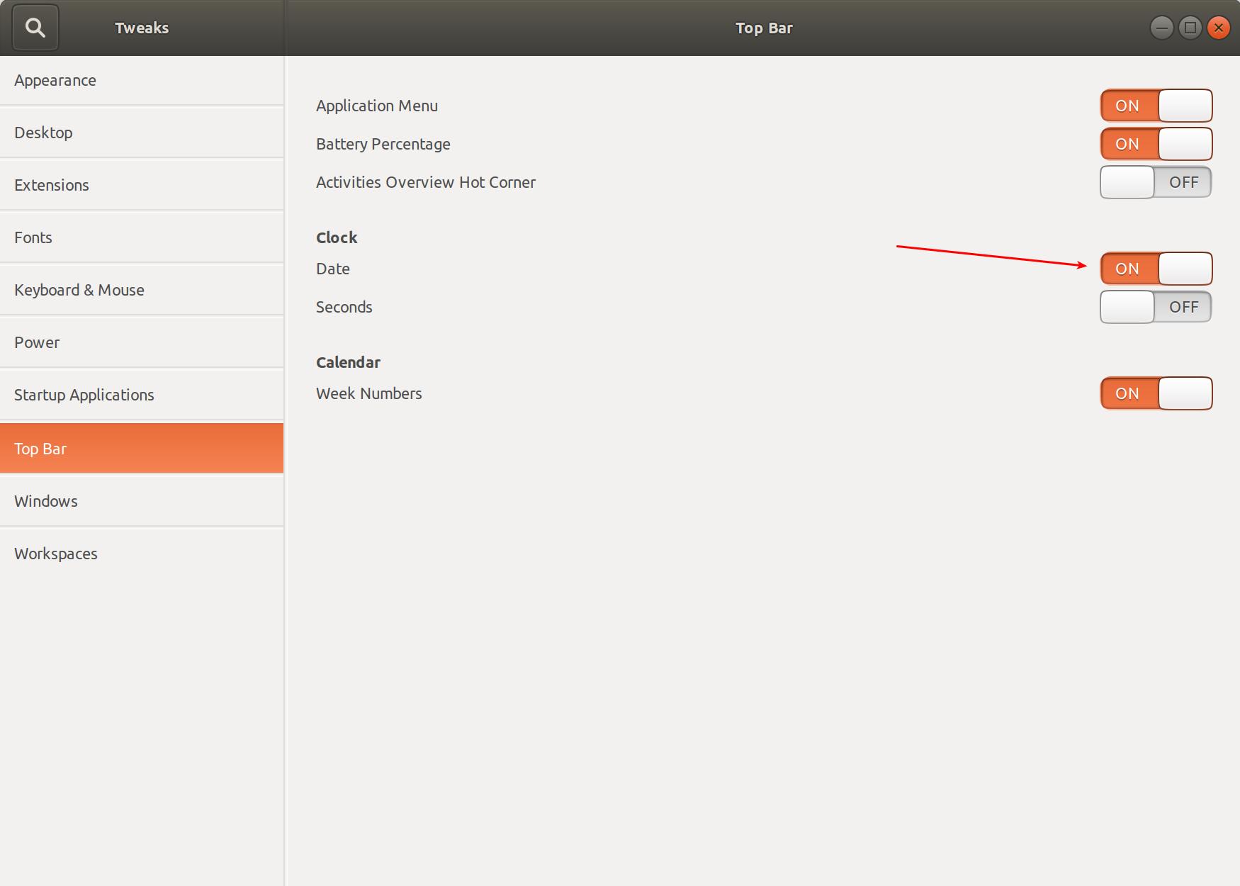 Включить часы в панели Ubuntu
